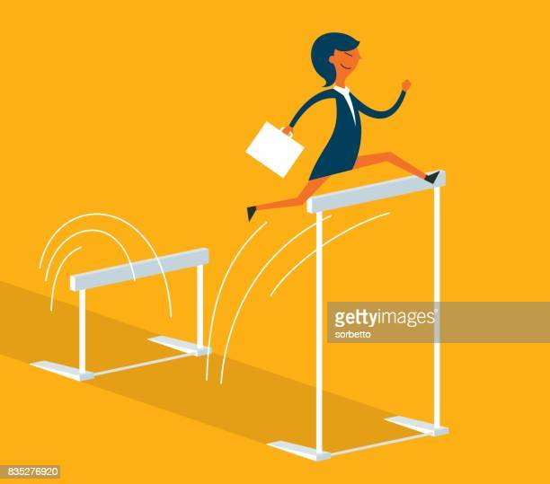 Businesswoman jumping over hurdle