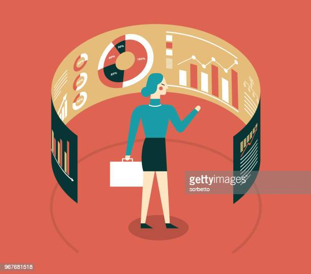 Businesswoman looking at data in front of electronic display
