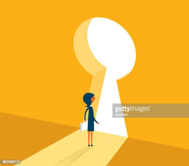 Businesswoman on standing looking at keyhole door