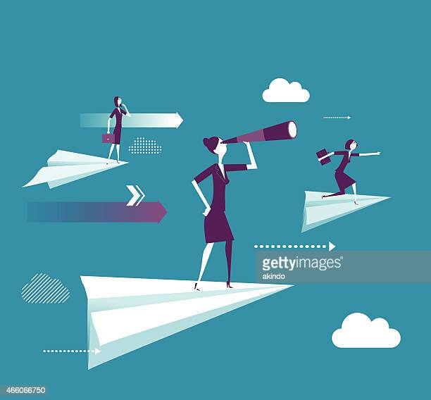 Businesswoman standing on the paper plane