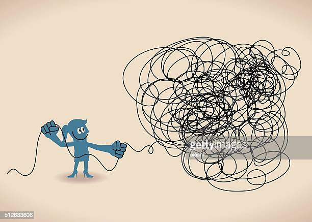 Businesswoman untangle a tangled messy knot (string, line)