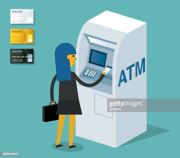 Businesswoman using ATM machine