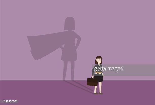 businesswoman with a cape shadow - heroes stock illustrations