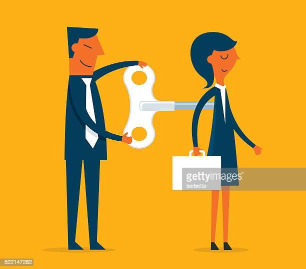 Businesswoman with wind-up key