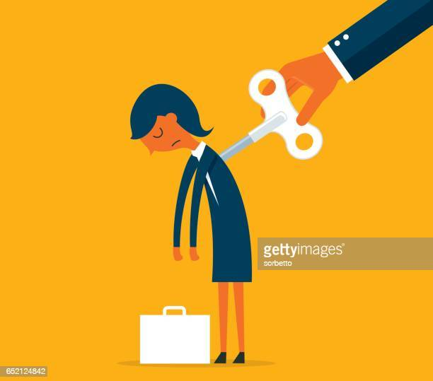 Businesswoman with wind-up key