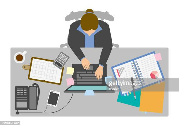 Businesswoman working at desk from above