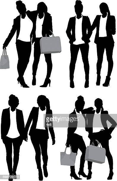 businesswomen standing - updo stock illustrations, clip art, cartoons, & icons