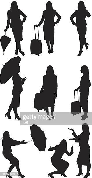 stockillustraties, clipart, cartoons en iconen met businesswomen with luggage and umbrella - nette schoen