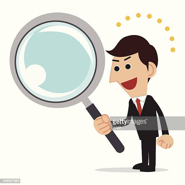 Bussiness man holding a Magnifier