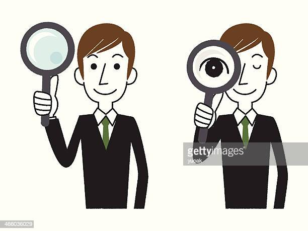 Bussinessman holding a Magnifier