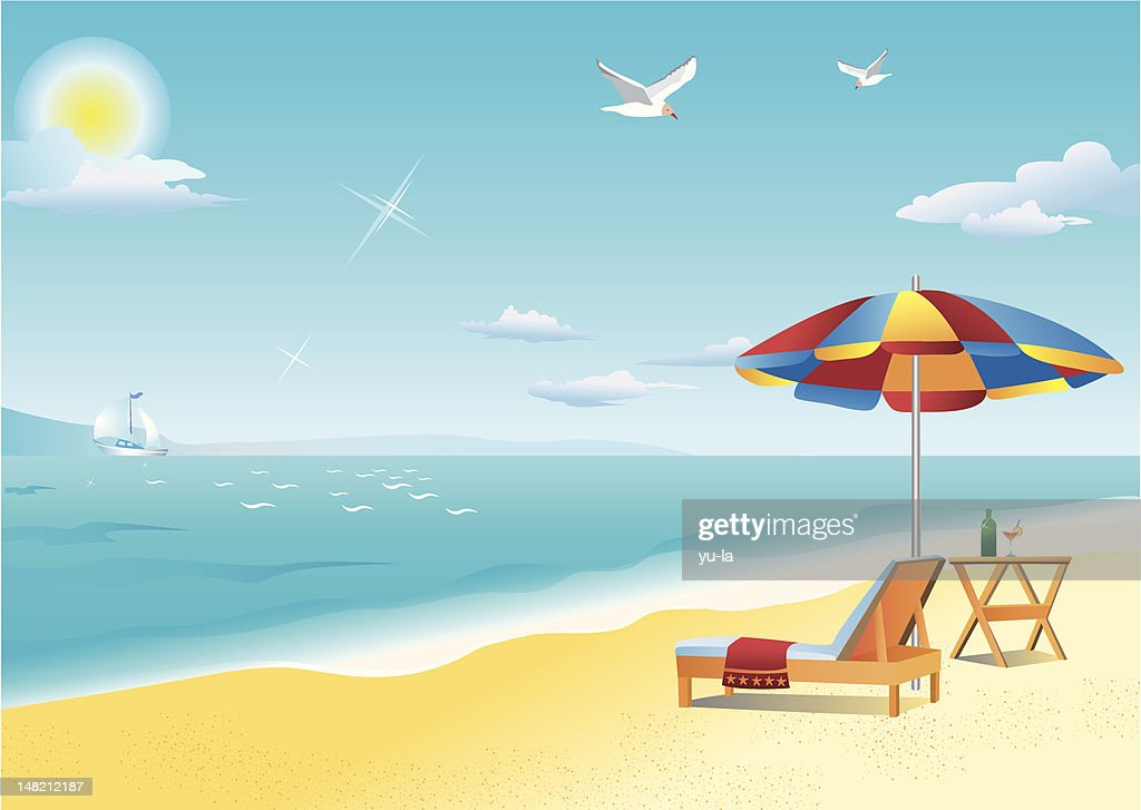 By the sea: chaise longue, folding table and beach umbrella