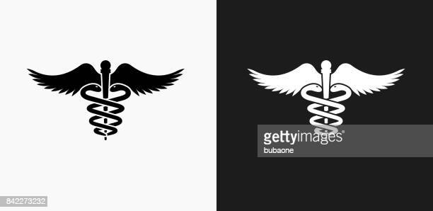 caduceus icon on black and white vector backgrounds - medical symbol stock illustrations, clip art, cartoons, & icons