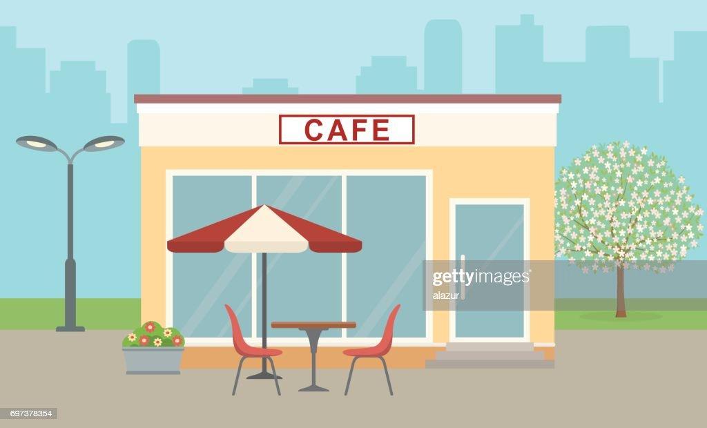 Cafe building on city background.
