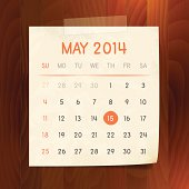 Calendar May 2014 vintage paper note on wood background
