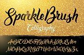 Calligraphic brushpen font with golden sparkles background