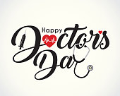 Calligraphic of happy doctor's day with symbol of heartbeat, syringe & stethoscope