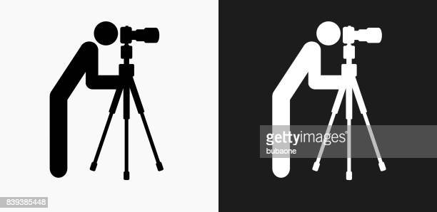 Camera Man Icon on Black and White Vector Backgrounds