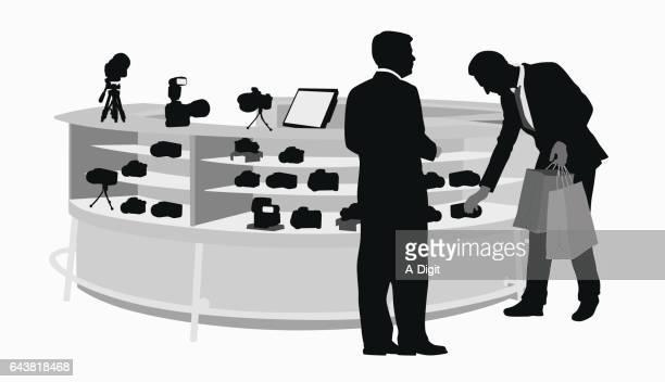 camera shopping salesman - camera tripod stock illustrations, clip art, cartoons, & icons