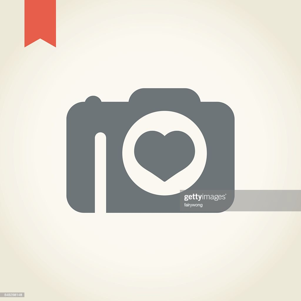 camera with heart shape icon