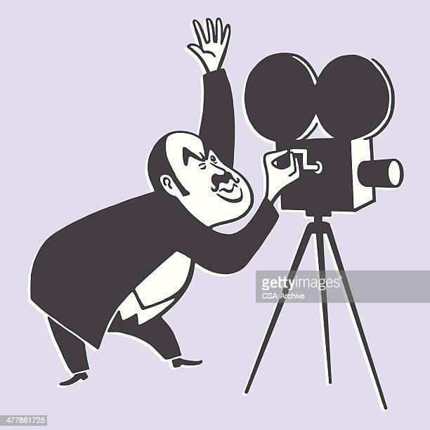 cameraman and a movie camera - director stock illustrations