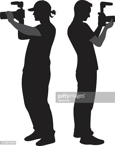 cameramen holding cameras silhouettes - camera stand stock illustrations, clip art, cartoons, & icons