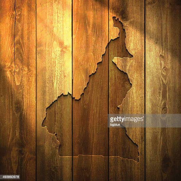 cameroon map on lit wooden background - cameroon stock illustrations, clip art, cartoons, & icons