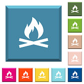 Camp fire white icons on edged square buttons