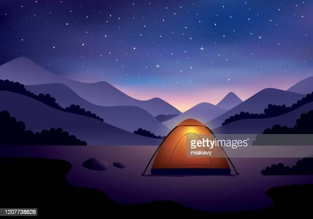 camping under starry night sky - wilderness stock illustrations