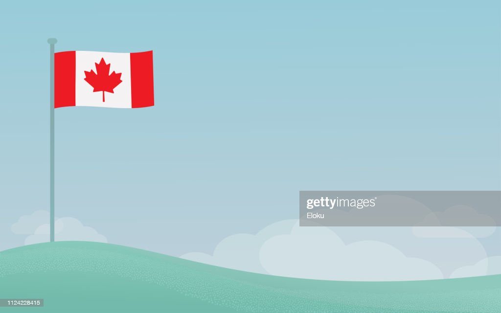 Canadian flag waving on a pole against blue sky background with copyspace