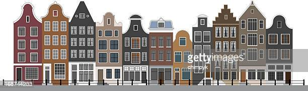 canal houses in amsterdam - amsterdam stock illustrations