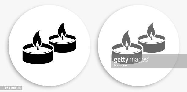 candle fire black and white round icon - candle stock illustrations