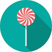 Candy circle icon with long shadow. Flat design style.
