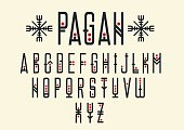 Capital letters in geometric ethnic style with red points.