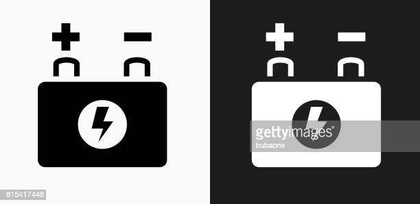 car battery icon on black and white vector backgrounds - car battery stock illustrations, clip art, cartoons, & icons