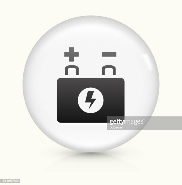 car battery icon on white round vector button - car battery stock illustrations, clip art, cartoons, & icons