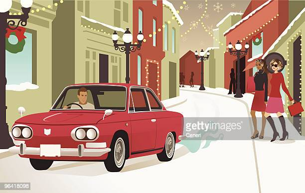 Car Driving Down Street Covered in Christmas Decorations