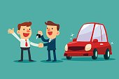 car salesman give a handshake and new car key to businessman