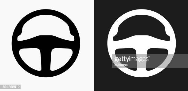car steering wheel icon on black and white vector backgrounds - steering wheel stock illustrations