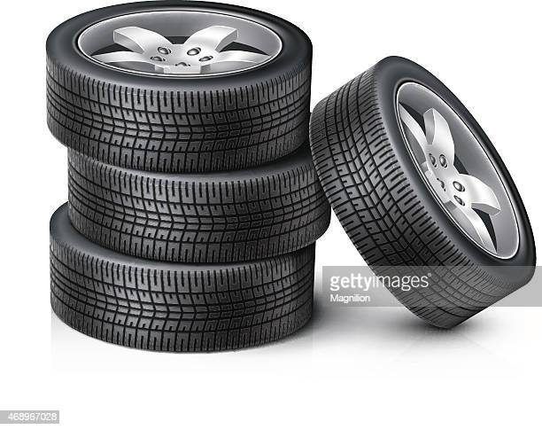 3 Car wheels stacked on top of each other with another wheel