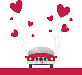 Car with red heart balloons