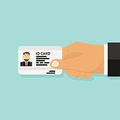 ID card in the person's hand, a person holds an ID card