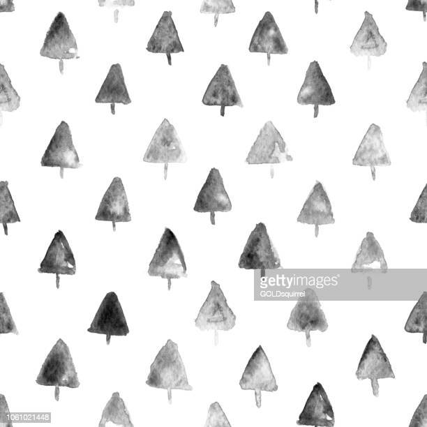 carelessly painted uneven ink black christmas trees on white paper card - irregular triangular patches of black paint - irregular texturizado stock illustrations