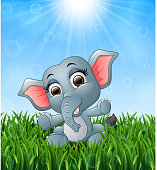 Cartoon baby elephant sitting in the grass on a background of bright sunshine
