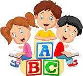Cartoon children sitting on alphabet blocks and reading
