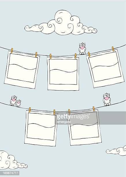a cartoon drawing of film pictures on a clothes line  - polaroid stock illustrations, clip art, cartoons, & icons