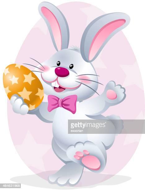cartoon easter rabbit holding easter egg - easter egg hunt stock illustrations, clip art, cartoons, & icons