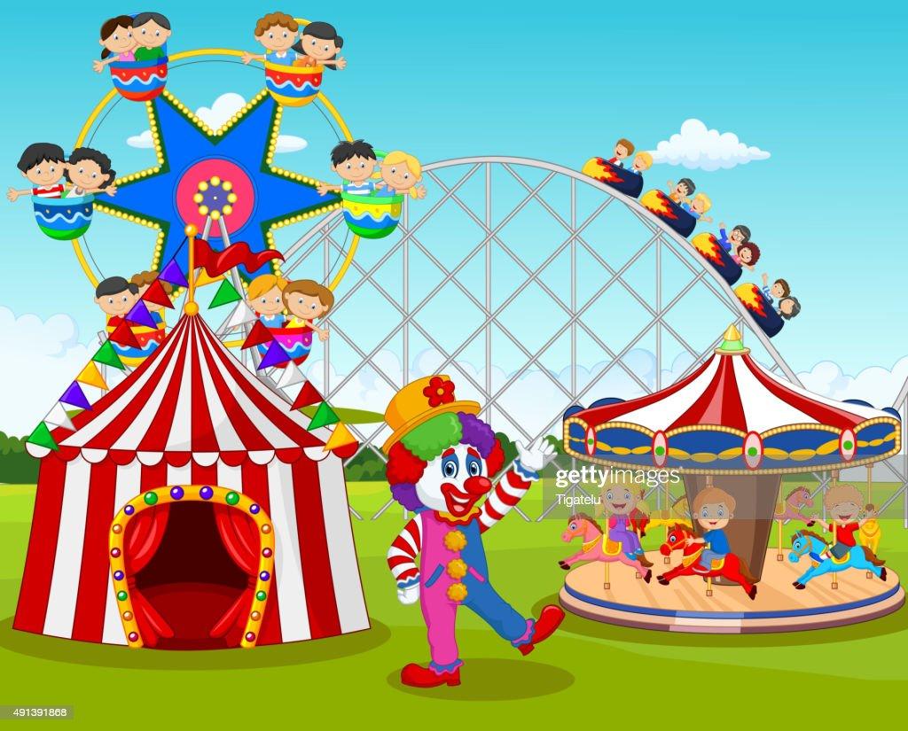 Cartoon happy children and clown in the amusement park