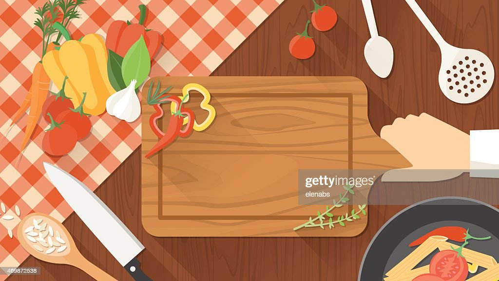 A cartoon image of a chef cutting vegetables