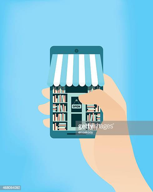 a cartoon image of a hand accessing a bookstore from a phone - small business stock illustrations