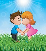 Cartoon little boy and girl kissing in the grass on a background of bright sunshine